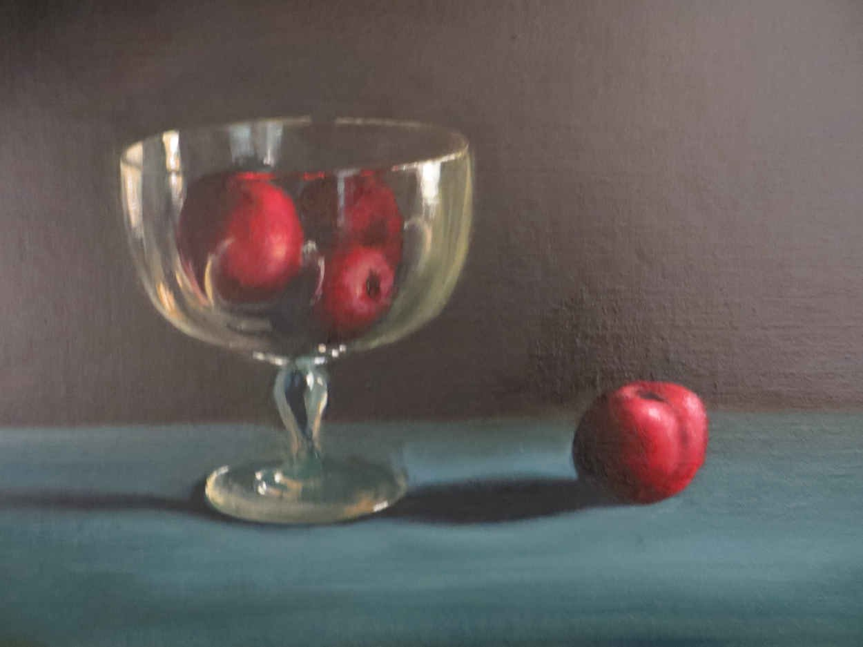 Plums in a glass